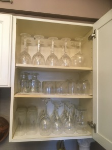 The cabinet above the dishwasher holds our glassware. On the the top shelf are the Waterford crystal wine glasses.