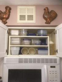 In the cabinet above the stove and microwave we keep our food storage containers. We shop and cook in a way that leaves no leftovers, but I like to cook in batches and store portions in the freezer, so we use quite thesis containers regularly on a rotating basis.